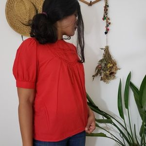 Puff sleeved red blouse